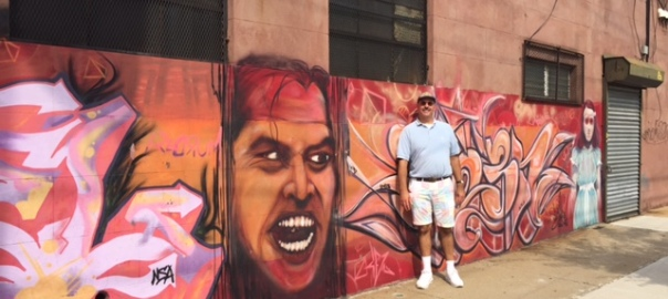 Blogger Justin Watrel in front of street art