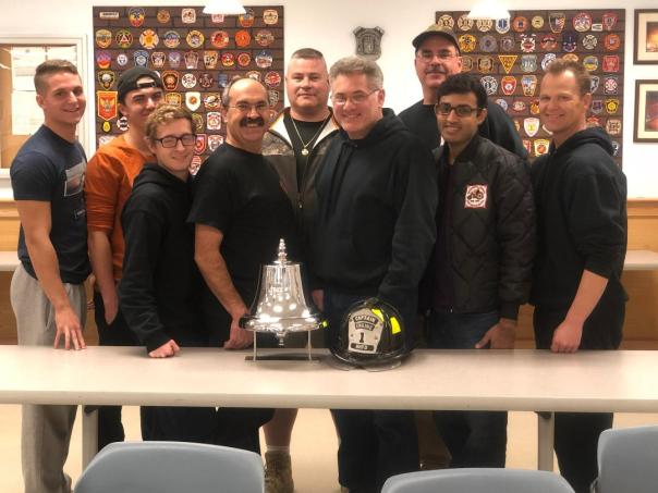 Brother's of Engine One with their bell